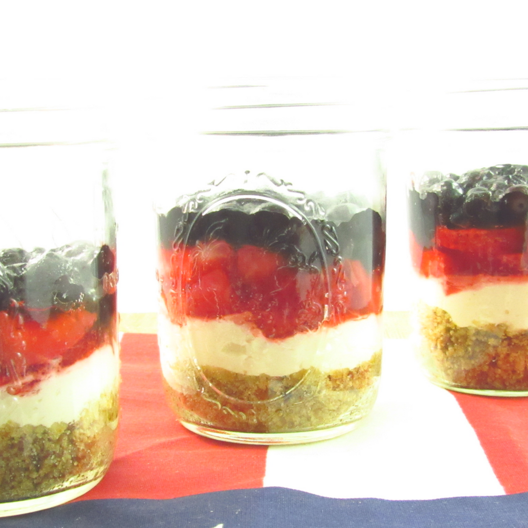 Sugar Free Patriotic Pretzel Salad Dessert with fresh strawberries and blueberries! Delicious dessert for Memorial Day, 4th of July, Labor Day, or just any ol' BBQ! www.nicoleis.com